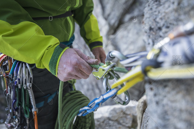 Close up of hands of rock climber belaying partner on Lovers Leap, Lake Tahoe, California, USA