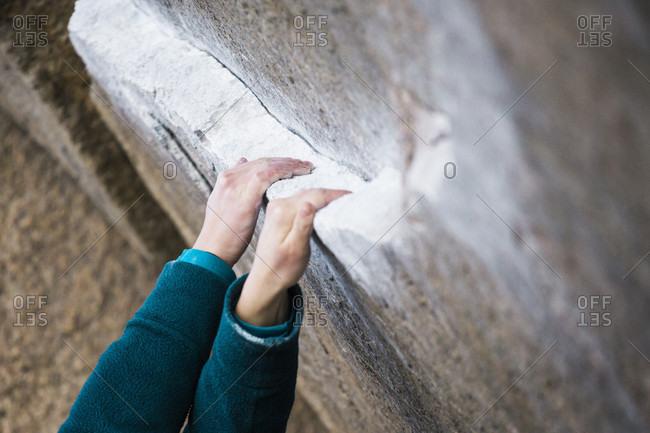 Close up of woman's hands while rock climbing, Iron Man Traverse, Bishop, California, USA