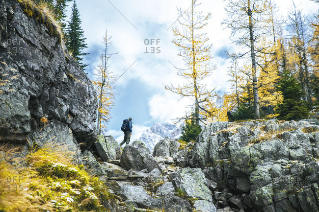 Backpacker hiking along Alpine circuit trail, Yoho National Park, Field, British Columbia, Canada