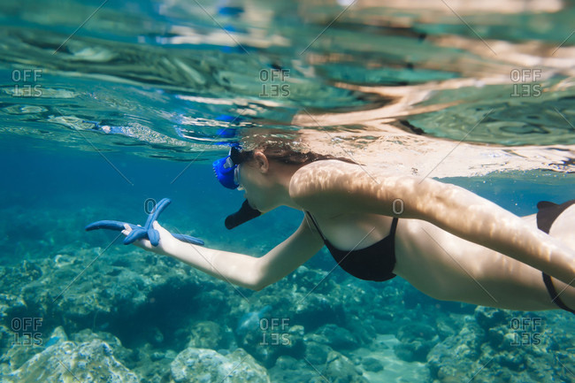 Indonesia, Bali, young woman snorkeling