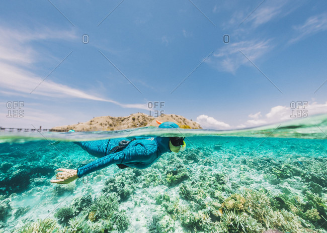 Girl is snorkeling in a turquoise water