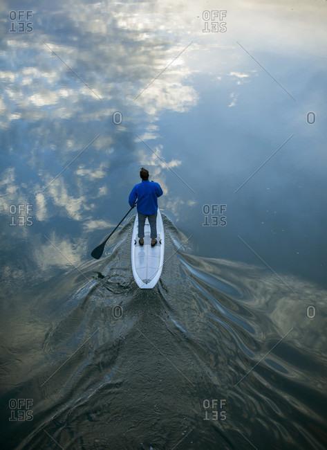 High angle view of man paddleboarding