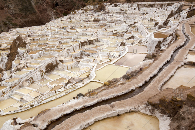Salt pans built on hillside, Maras, Cusco Region, Peru