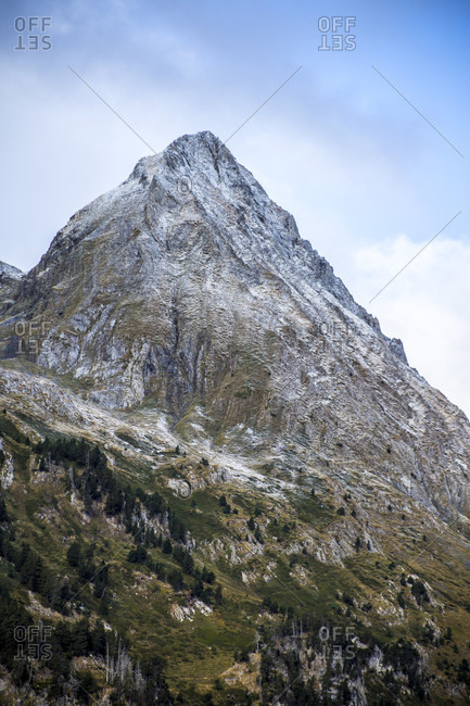 Mountain peak in Pyrenees under thin coat of snow, Benasque, Huesca, Spain