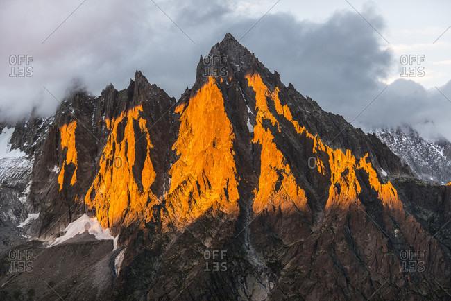Sunlight illuminating Aiguille du Moine summit at dusk, Haute-Savoie, France