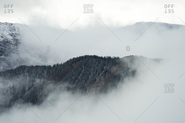 Mountains cloaked in fog, Crested Butte, Colorado, USA