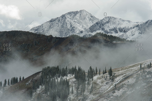 Scenery with snowcapped mountains and fog, Crested Butte, Colorado, USA