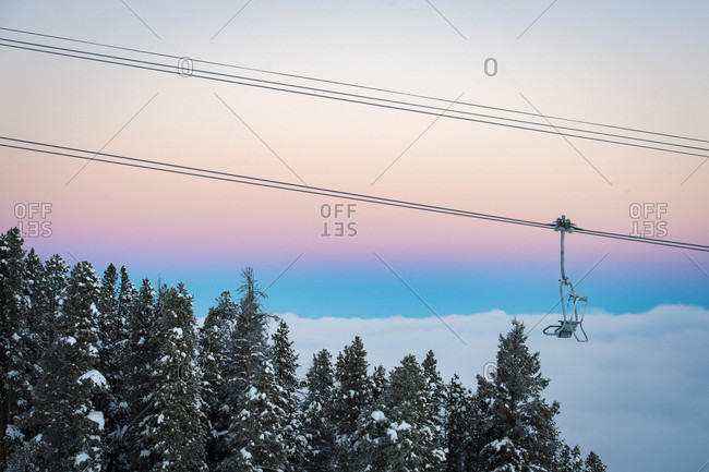 Empty ski lift against moody sky at dusk, Aspen, Colorado, USA