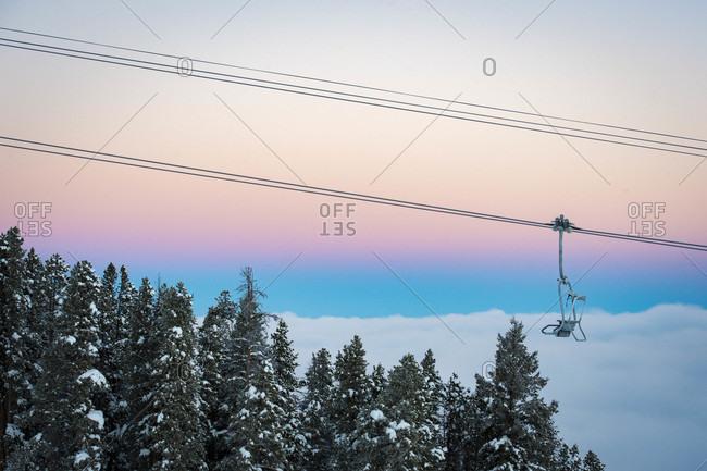 Empty ski lift against moody sky at dusk, Aspen, Colorado, USA