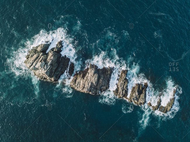 High angle view of chain of rocks standing out of ocean waves, Tenerife, Canary Islands, Spain