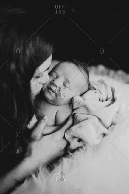 Mother embracing newborn