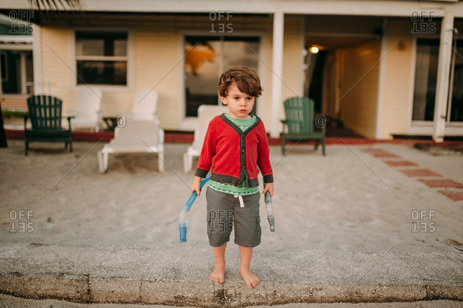 Brunette toddler ready to snorkel at vacation beach house