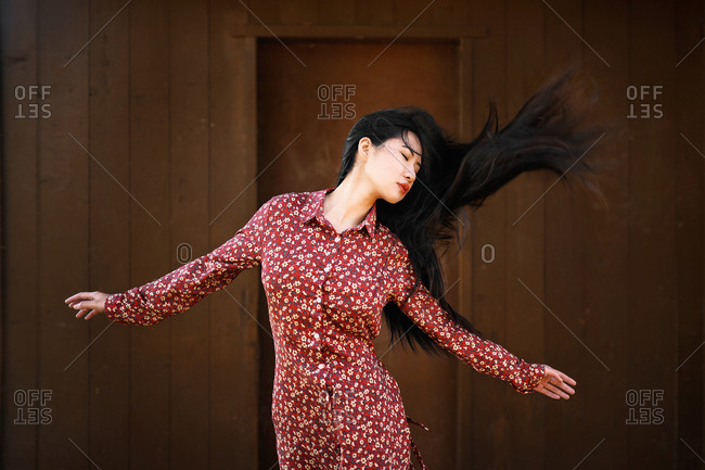 Asian woman shaking hair