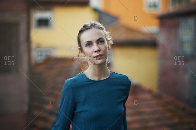 Woman standing at handrail in city