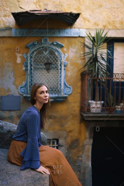 Woman sitting on the ledge