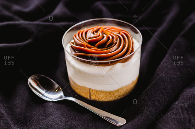 Dessert in cup with caramel mousse
