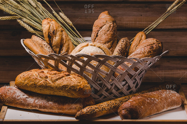 Composition of fresh bread loaves in basket