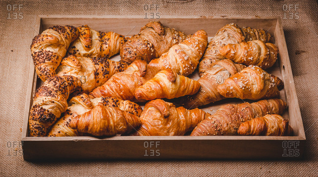 Mix of golden croissants on wood