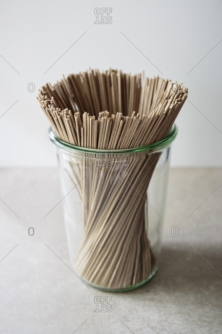 Uncooked soba noodles in a jar