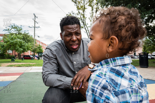 Father having conversation with toddler son