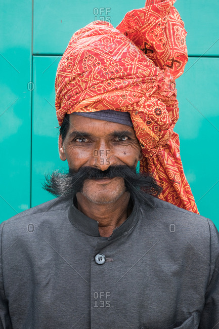 Agra, India - August 5, 2017: Man with long mustache wearing brightly colored turban