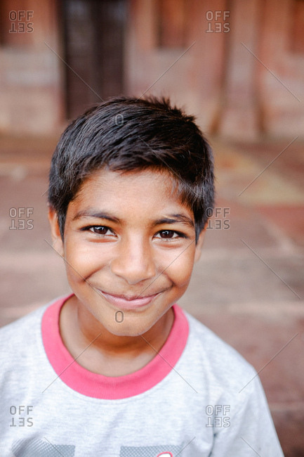 Fatehpur Sikri, India - August 5, 2017: Portrait of a young boy visiting tomb in Fatehpur Sikri, India
