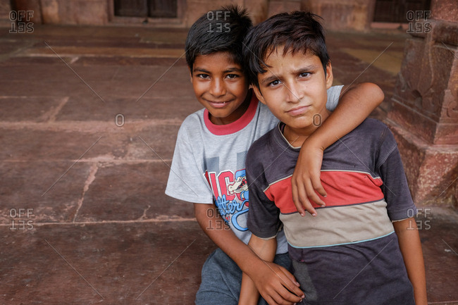 Fatehpur Sikri, India - August 5, 2017: Two boys visiting tomb in Fatehpur Sikri, India