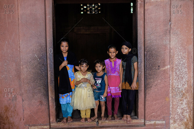 Fatehpur Sikri, India - August 5, 2017: Group of children visiting tomb in Fatehpur Sikri, India