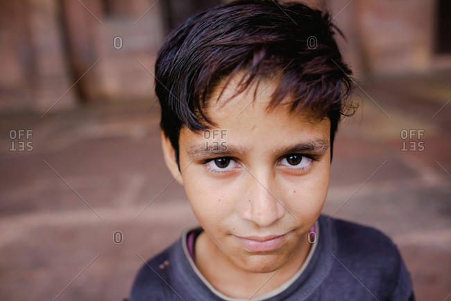 Fatehpur Sikri, India - August 5, 2017: Portrait of a boy visiting tomb in Fatehpur Sikri, India