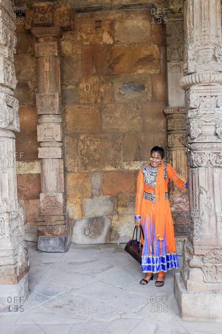 New Delhi, India - August 3, 2017: Smiling woman at the Qutb Minar in New Delhi, India