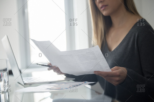 Young woman doing paper work