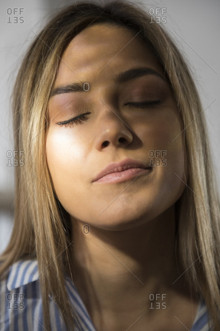 Portrait of young woman with closed eyes