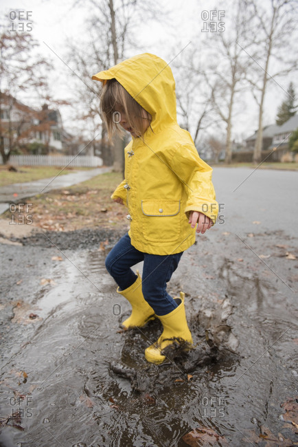 Girl (2-3) playing in puddle
