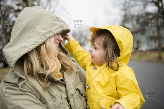 Mother carrying daughter (2-3) outdoors