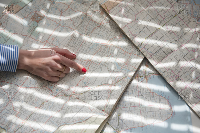 Woman pointing to map