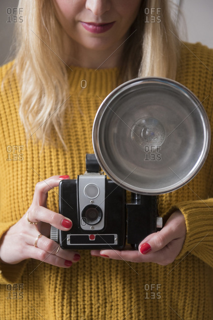 Woman holding old camera
