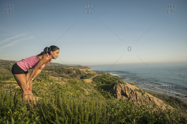 USA, California, Newport Beach, Woman resting and looking at sea