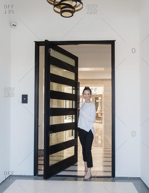 Woman standing in doorway of house