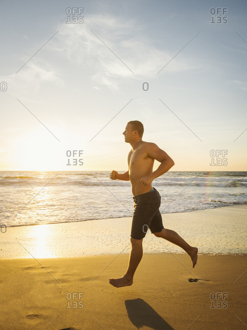 Man jogging along beach