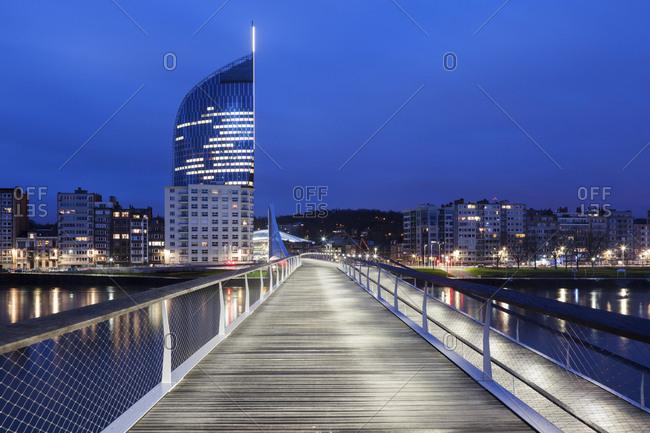 Belgium, Wallonia, Liege, Footbridge and cityscape