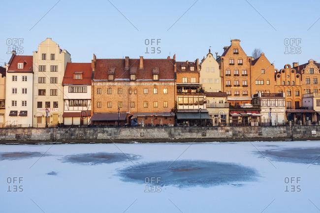 January 3, 2016: Poland, Pomerania, Gdansk, Frozen Vistula river and townhouses