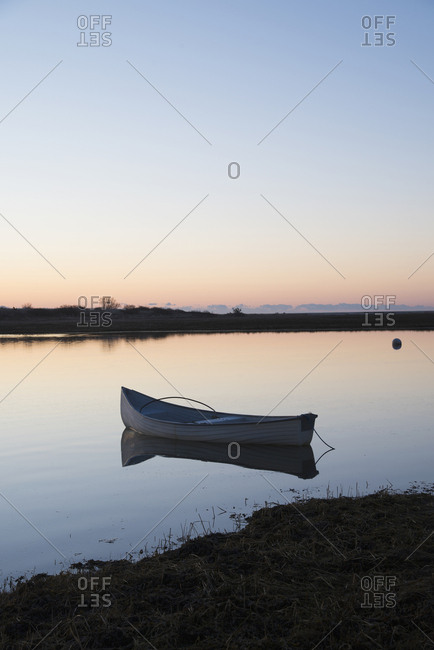 USA, Massachusetts, Cape Cod, Chatham, Boat reflecting in water at dawn