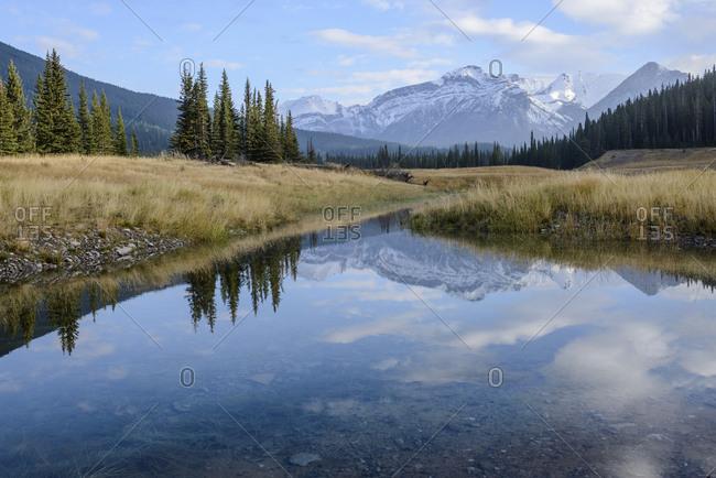 Canada, Alberta, Banff, Mountain peak reflecting in lake in Banff National Park