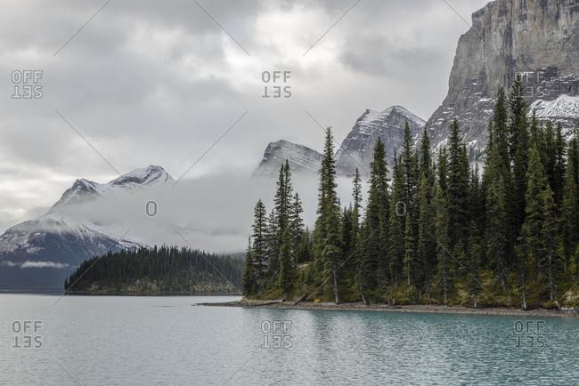 Canada, Alberta, Jasper, Clouds above mountains and Maligne Lake