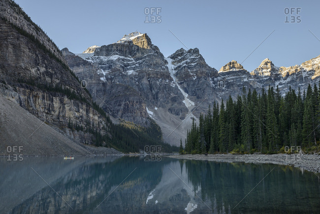 Canada, Alberta, Banff, Moraine Lake surrounded with mountains at sunrise