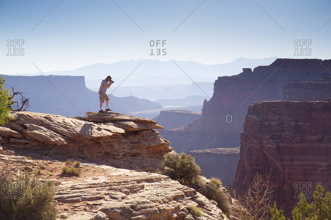 Tourist taking photograph at Canyonlands National Park