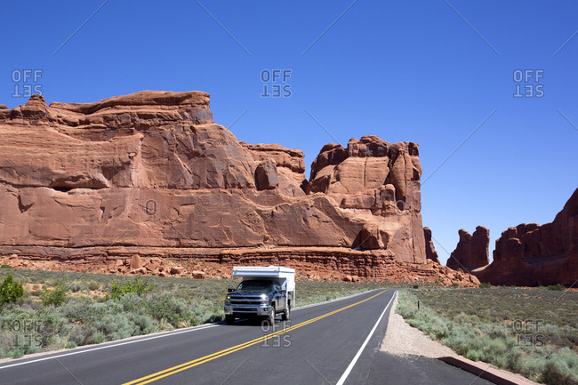 Camper truck on two lane highway in Canyonlands National Park