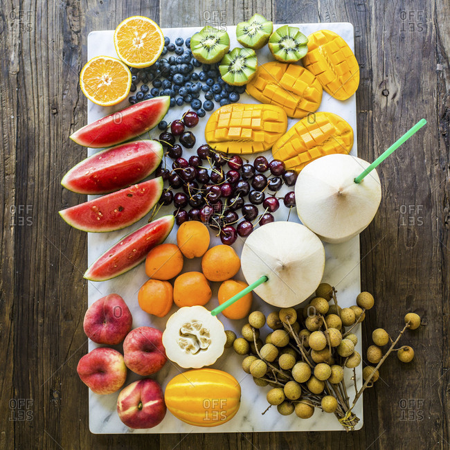 Color coordinated arrangement of miscellaneous fruits on sheet