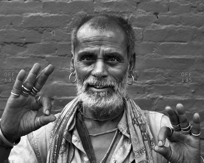 Pashupatinath Temple, Kathmandu, Nepal - August 3, 2017: Portrait of a holy man at Shree Pashupatinath Temple, Kathmandu, Nepal on August 3, 2017