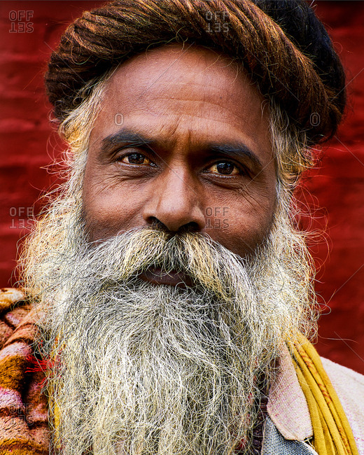 Pashupatinath Temple, Kathmandu, Nepal - August 3, 2017: Portrait of a holy man at Shree Pashupatinath Temple, Kathmandu, Nepal on August 3, 2017